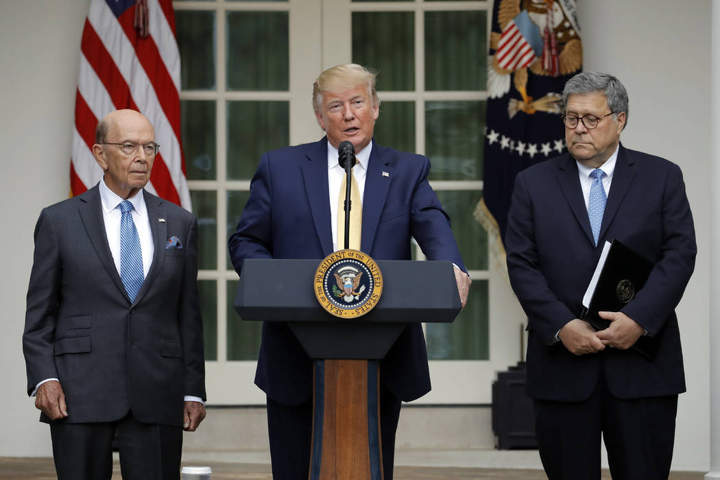 President Donald Trump is joined by Commerce Secretary Wilbur Ross, left, and Attorney General ...