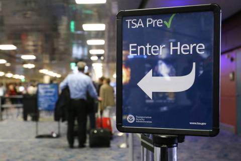 Passengers wait in a Transportation Security Administration Precheck screening line at Terminal ...