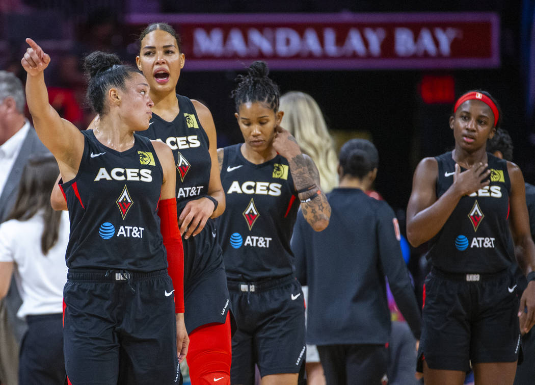 Las Vegas Aces guard Kayla McBride, left, leads her team back onto the floor for overtime versu ...
