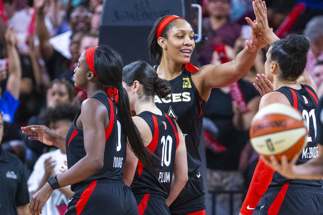 Las Vegas Aces forward A'ja Wilson celebrates a win with teammates after their overtime victory ...