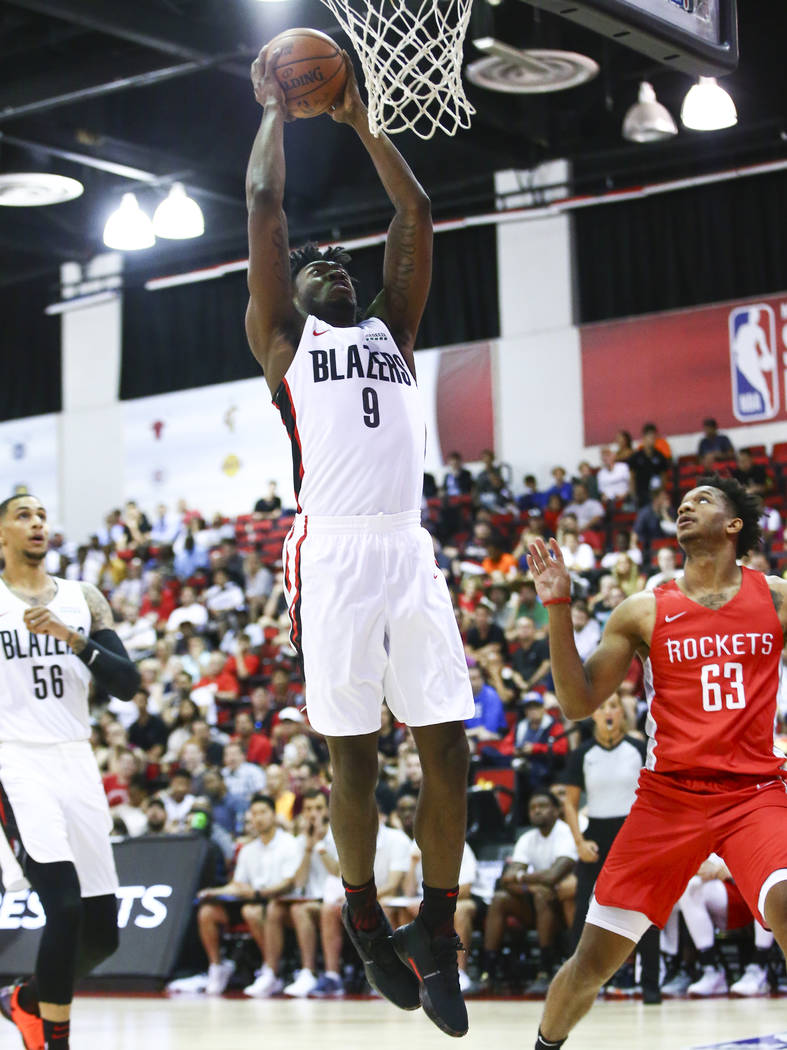 Portland Trail Blazers' Nassir Little (9) goes to the basket against the Houston Rockets during ...