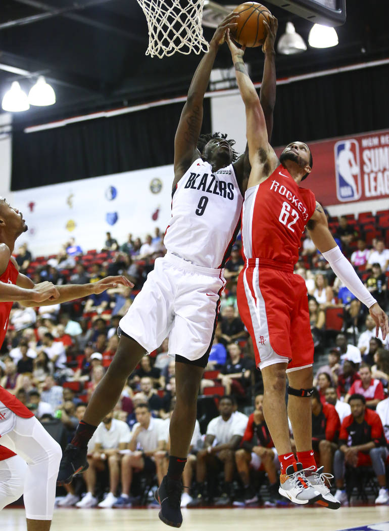 Portland Trail Blazers' Nassir Little (9) battles for a rebound against Houston Rockets' Isaiah ...