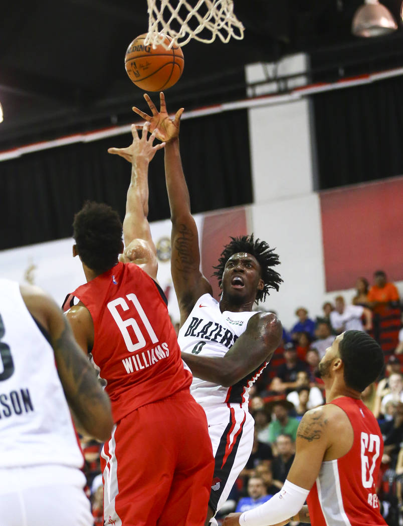 Portland Trail Blazers' Nassir Little (9) shoots over Houston Rockets' Johnathan Williams (61) ...