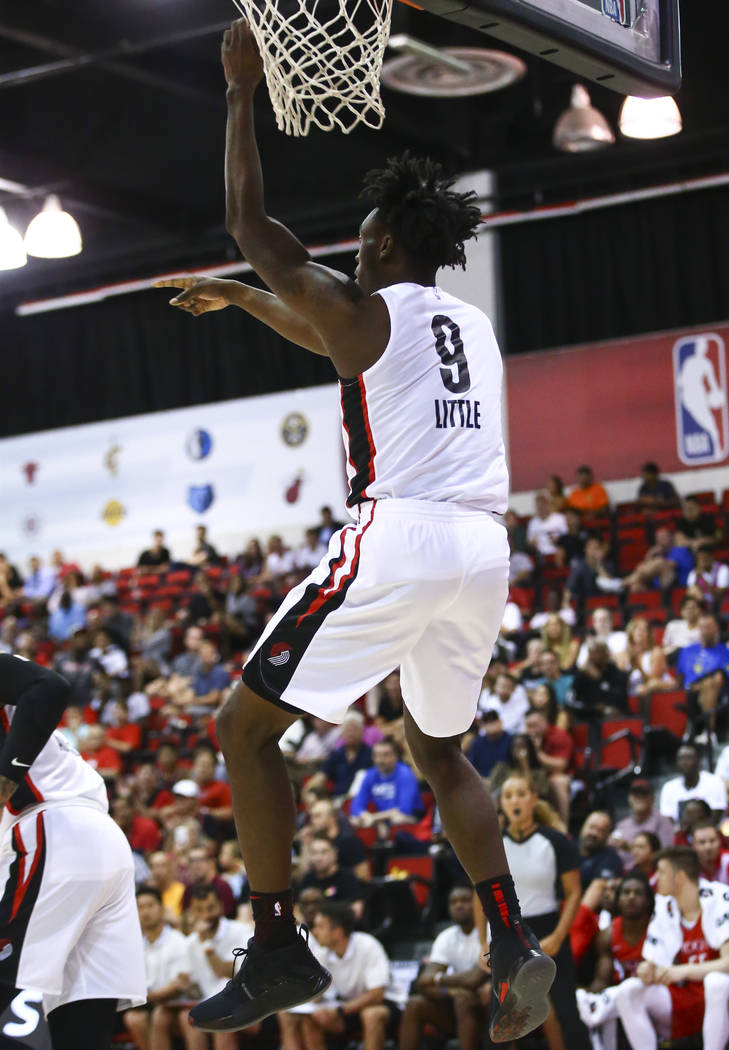 Portland Trail Blazers' Nassir Little (9) dunks against the Houston Rockets during the first ha ...