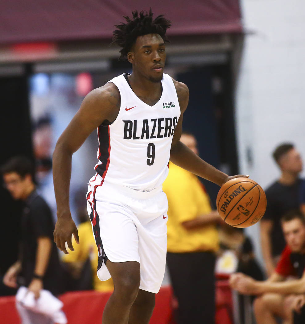 Portland Trail Blazers' Nassir Little (9) brings the ball up court against the Houston Rockets ...