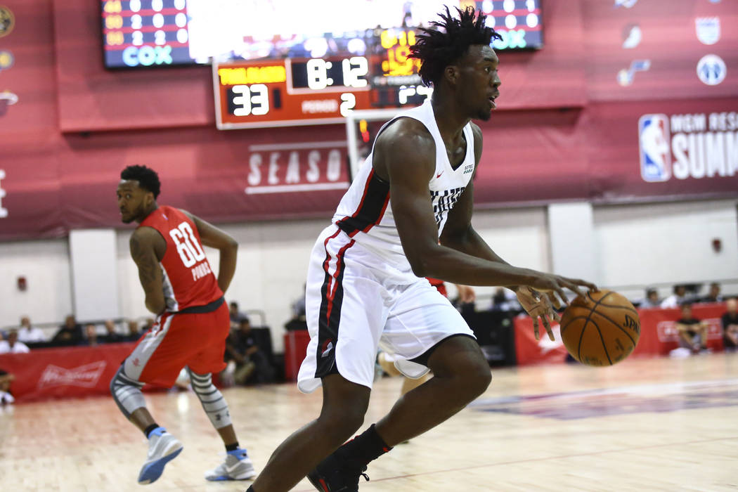 Portland Trail Blazers' Nassir Little (9) drives to the basket against the Houston Rockets duri ...