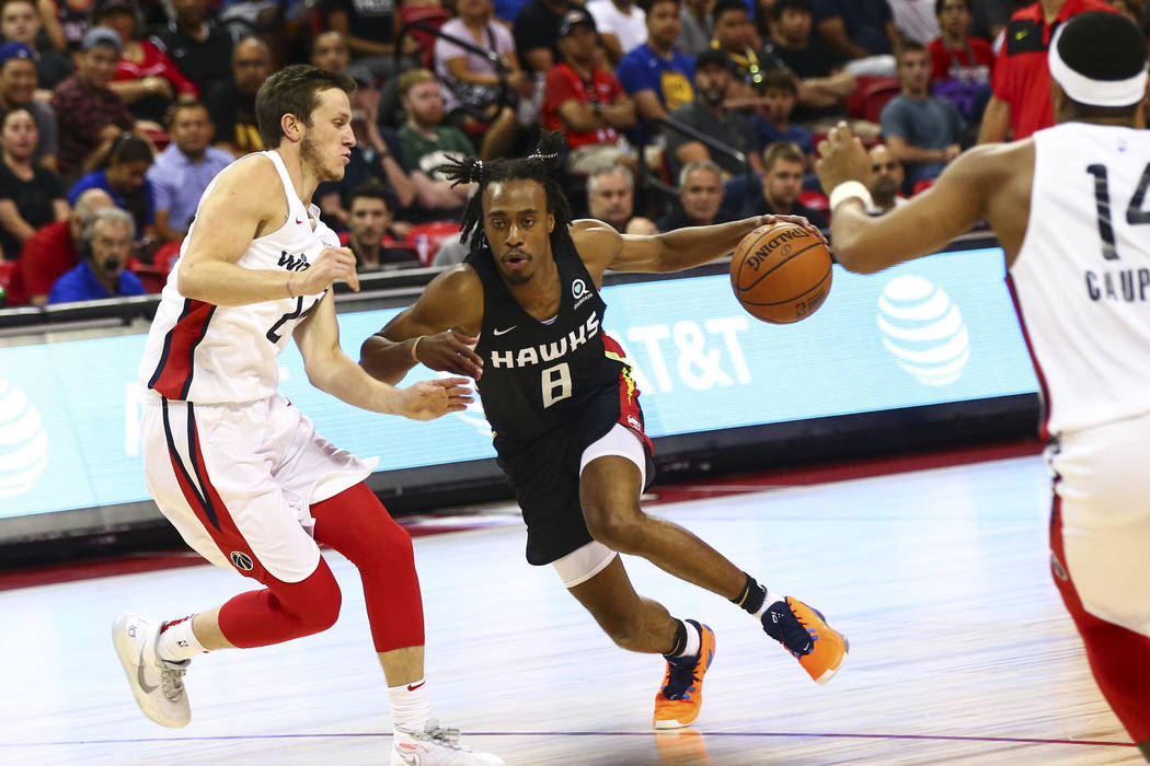 Atlanta Hawks' Tahjre McCall (8) drives to the basket against the Washington Wizards during the ...