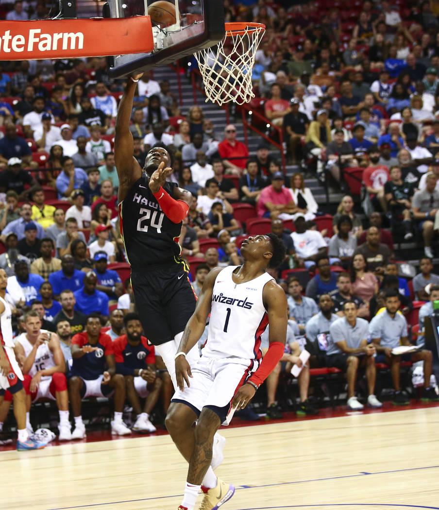 Atlanta Hawks' Bruno Fernando (24) goes to the basket past Washington Wizards' Admiral Schofiel ...