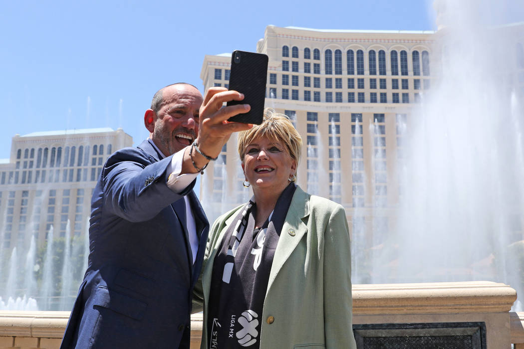 Major League Soccer Commissioner Don Garber, left, and Las Vegas Mayor Carolyn Goodman take a s ...
