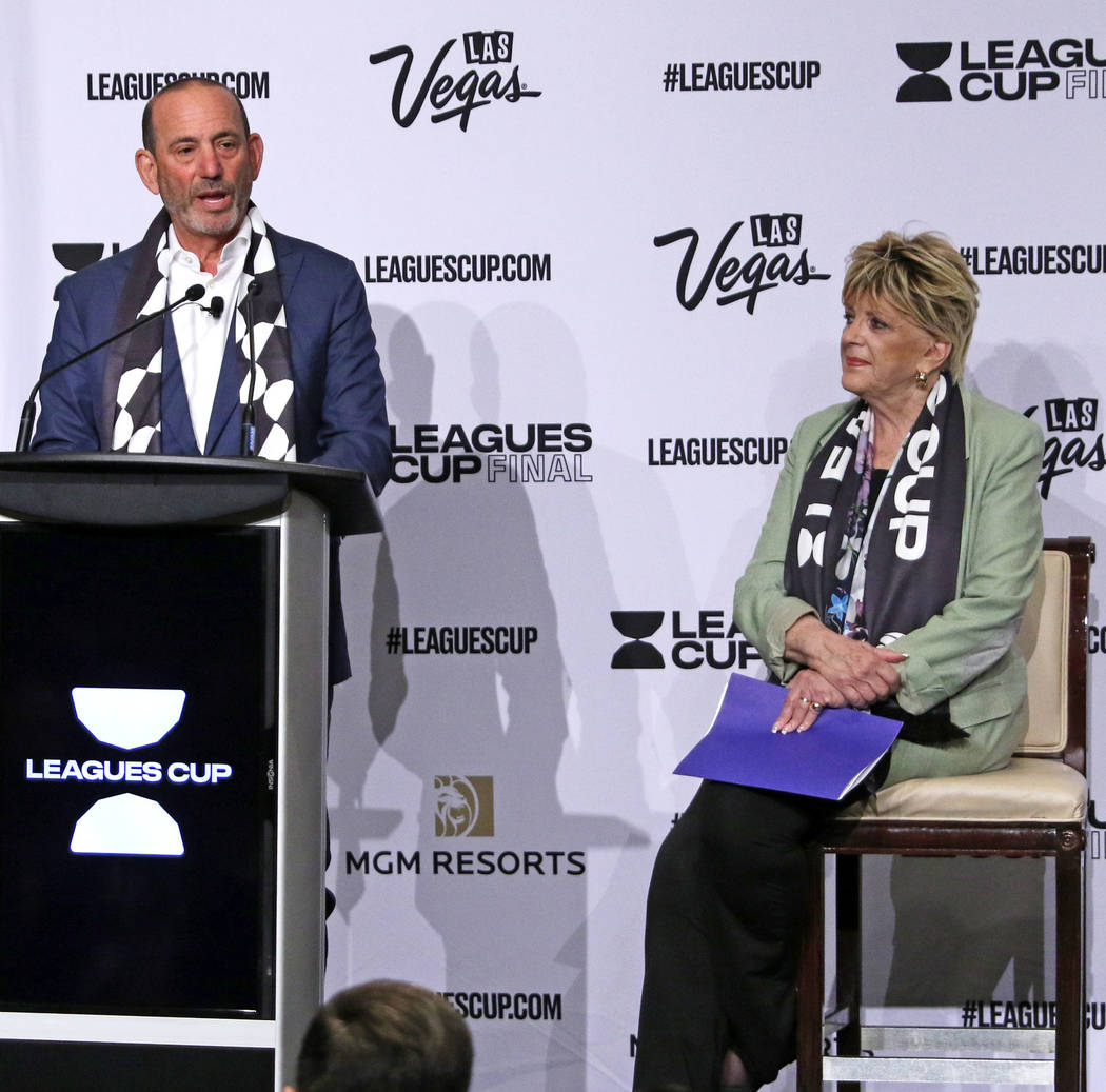 Major League Soccer Commissioner Don Garber, left, announces the Liga MX-MLS Leagues Cup Final ...