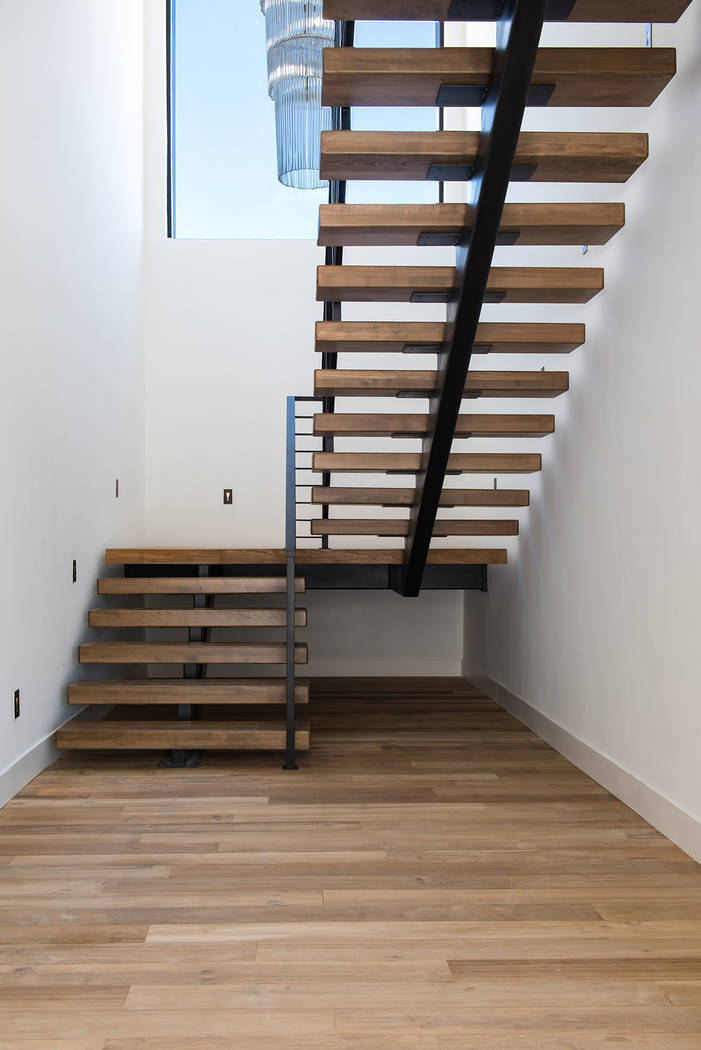 The home features a floating staircase. (Jewel Homes)