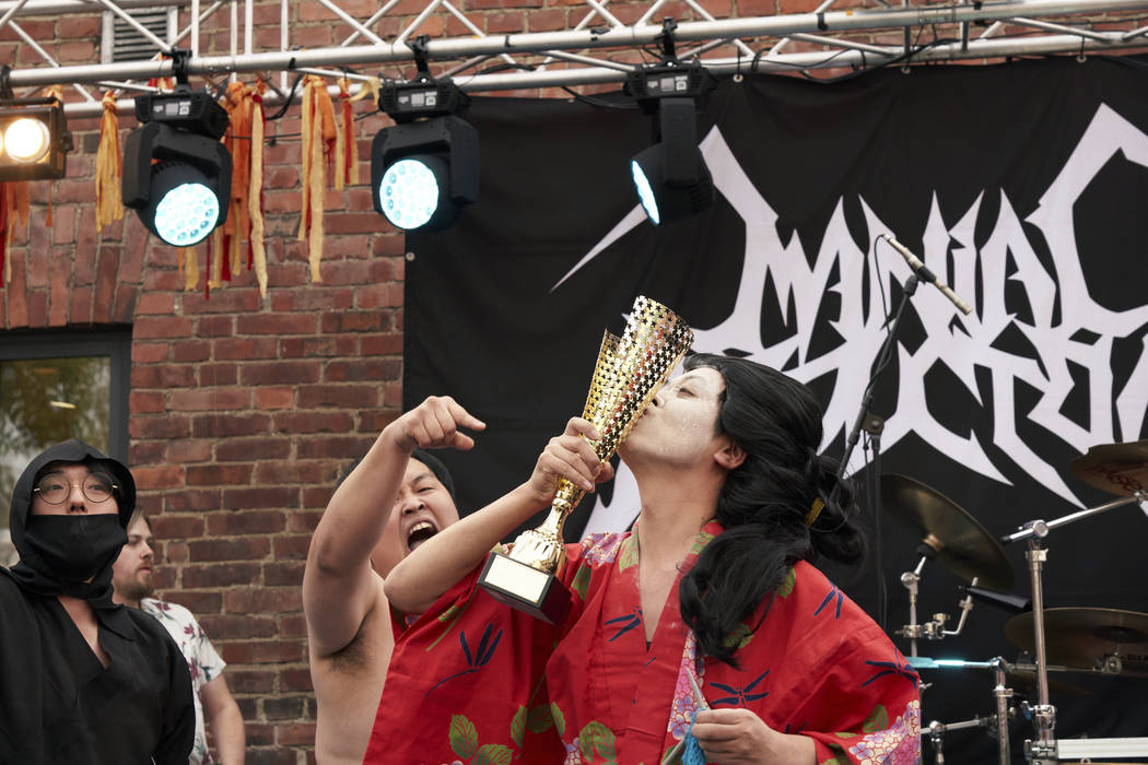The Japanese team Giga Body Metal react with the trophy after being crowned Heavy Metal Knittin ...