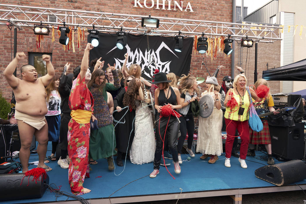 The competitors of the first Heavy Metal Knitting world championship react on stage, Thursday, ...