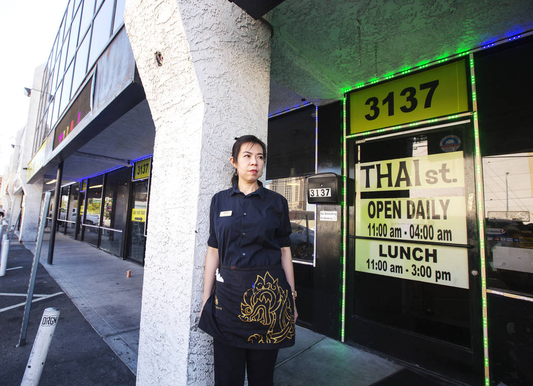 Apple Mollette takes a portrait outside of her job at the Thai St. restaurant at Siegel Plaza W ...