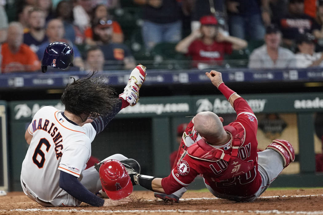 Houston Astros' Jake Marisnick, (6) collides Los Angeles Angels catcher Jonathan Lucroy (20) wh ...