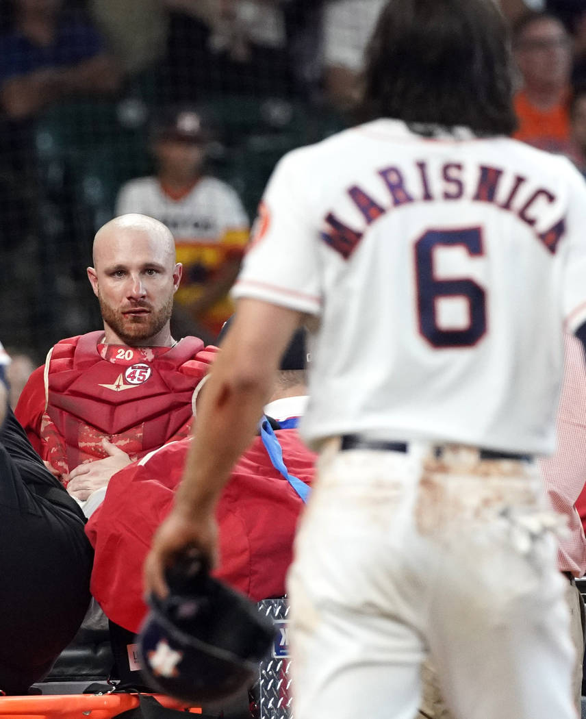 Los Angeles Angels' Jonathan Lucroy, left, is carted off the field after colliding with Houston ...