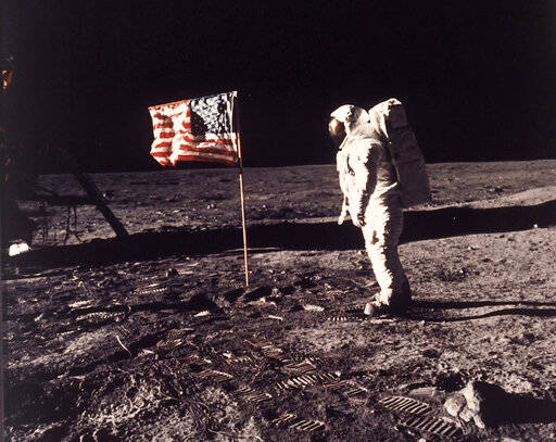 FILE - In this image provided by NASA, astronaut Buzz Aldrin poses for a photograph beside the ...