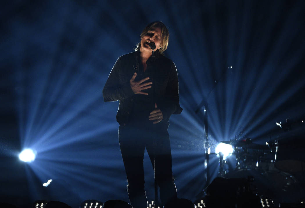 """Keith Urban performs """"Burden"""" at the 54th annual Academy of Country Music Awards at t ..."""