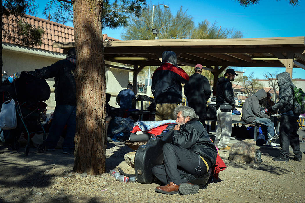 Clients relax at the city of Las Vegas' homeless courtyard in Las Vegas, Thursday, Jan. 24, 201 ...
