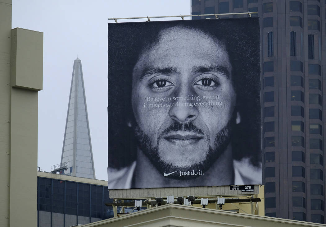 FILE - In this Sept. 5, 2018, file photo, a large billboard stands on top of a Nike store showi ...