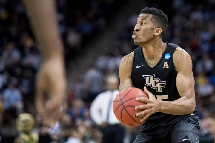 Central Florida guard Aubrey Dawkins looks to shoot against VCU during the first half of a firs ...