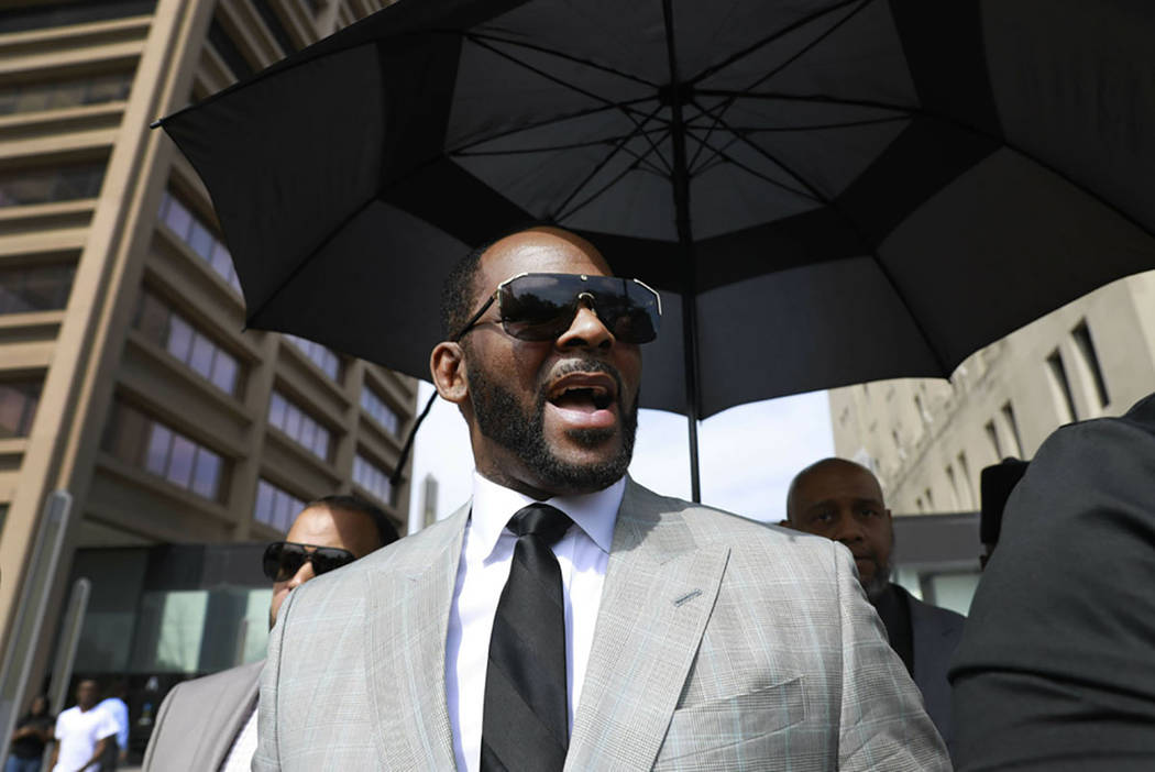 Musician R. Kelly departs the Leighton Criminal Court building after pleading not guilty to 11 ...