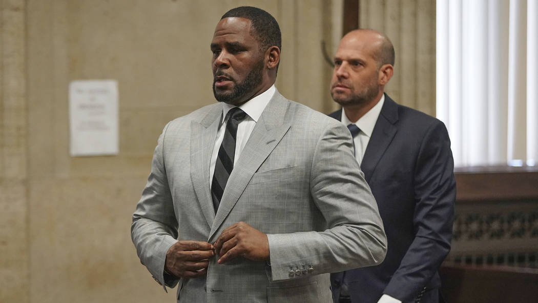 FILE - In this June 6, 2019, file photo, singer R. Kelly pleaded not guilty to 11 additional s ...