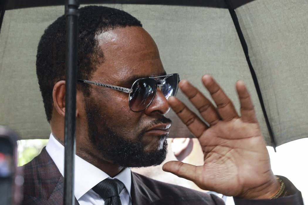 In a June 26, 2019, file photo, Musician R. Kelly departs from the Leighton Criminal Court buil ...