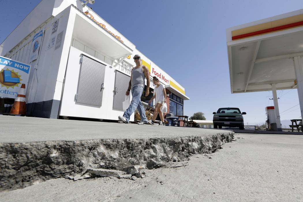 FILE - This July 6, 2019 photo shows crack in a gas station's driveway in the aftermath of an e ...