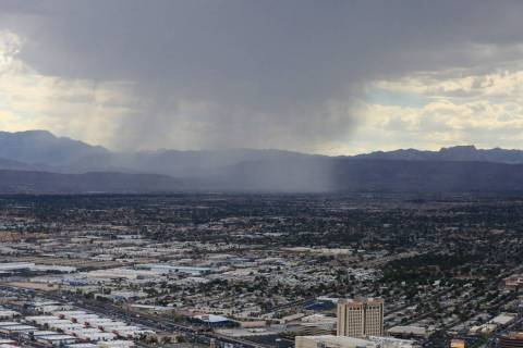 A rain shower passes over Summerlin in Las Vegas on Friday, July 12, 2019. Brett Le Blanc/Las V ...