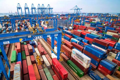 In a Tuesday, May 14, 2019, photo, containers are piled up at a port in Qingdao in east China's ...