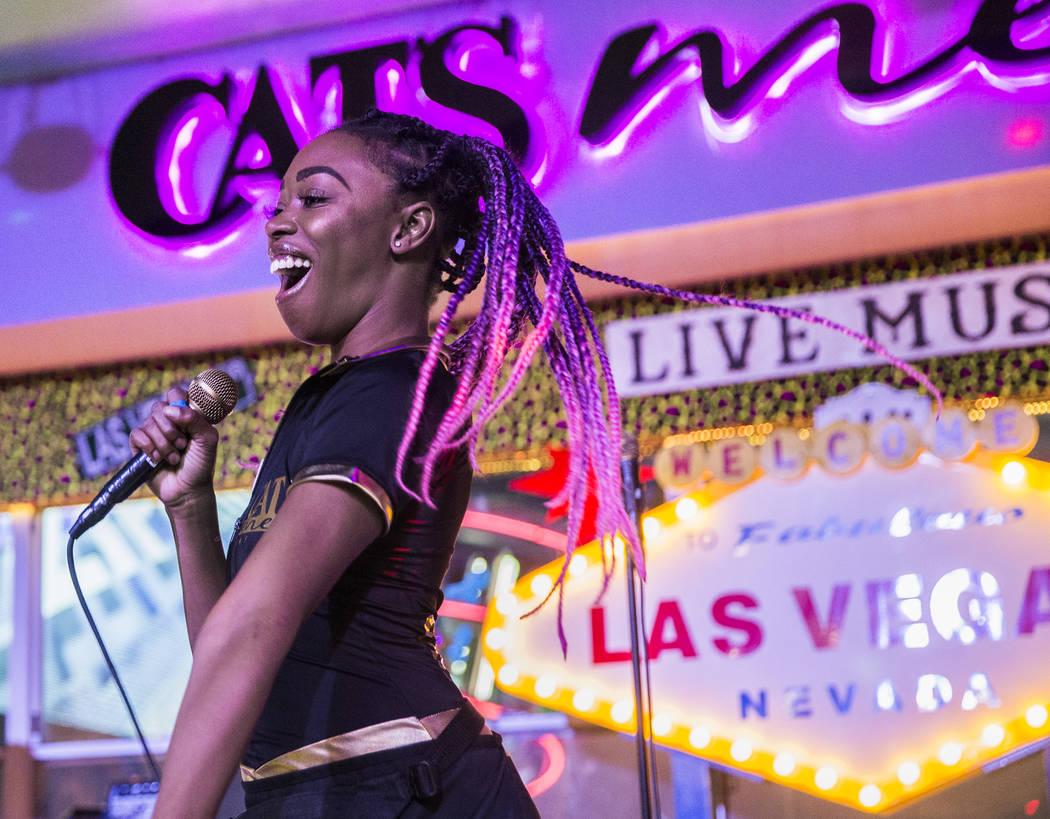 """Xstal Yumi performs Gwen Stefani's """"Hollaback Girl"""" at Cat's Meow karaoke club on Fri ..."""