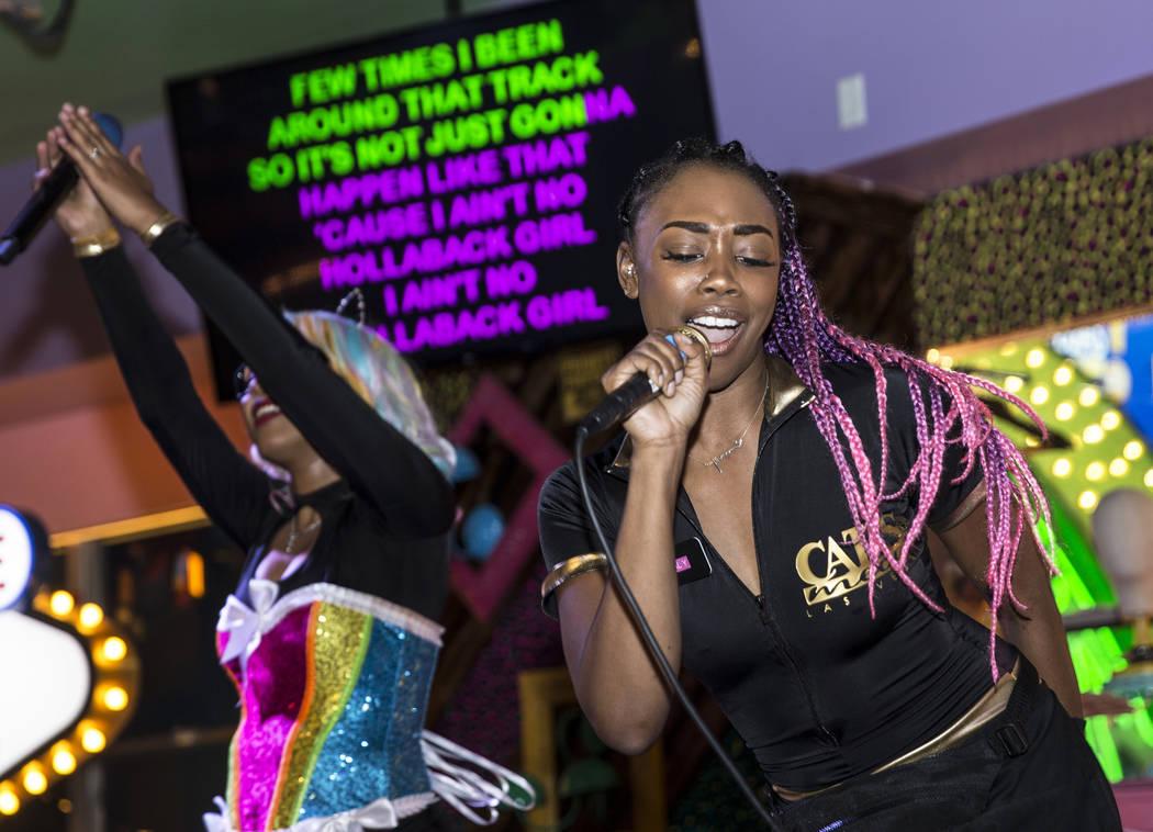 "Xstal Yumi, right, and MC Primrose Martin perform Gwen Stefani's ""Hollaback Girl"" at ..."