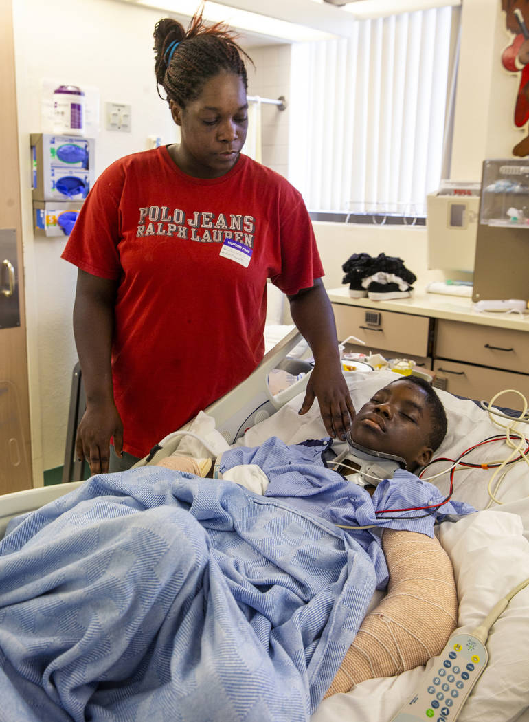 Thylicia McKnight, above, checks on her son Lennie Modica, 9, who is in recovery in the pediatr ...