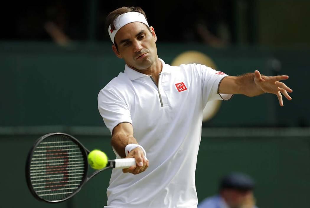 Switzerland's Roger Federer returns the ball to Spain's Rafael Nadal during a men's singles sem ...
