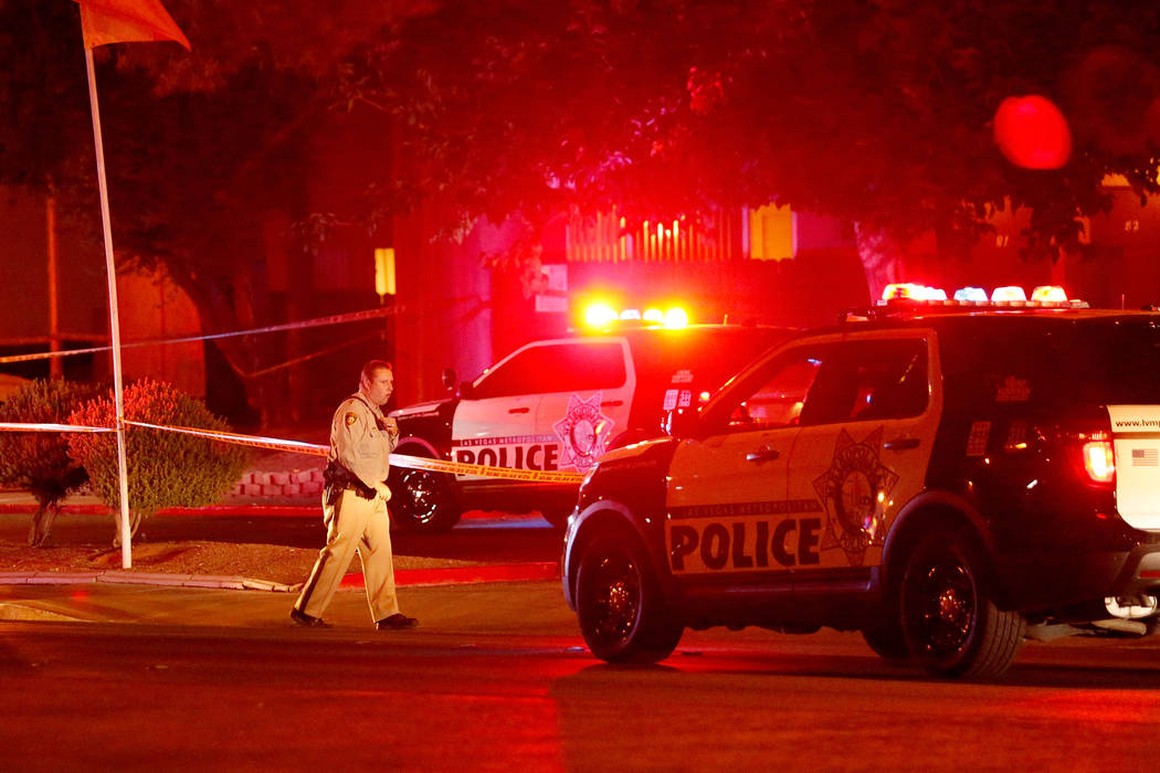 A large police presence is visible near an apartment complex in the 5300 block of East Tropican ...