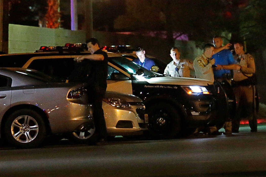 Las Vegas police investigate an officer-involved shooting near an apartment complex in the 5300 ...
