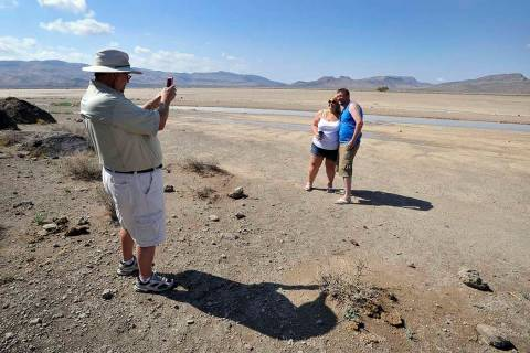 Dean Baumgartner, left, of Adventure Photo Tours, photographs Becky Cooper and Shane Cooper of ...