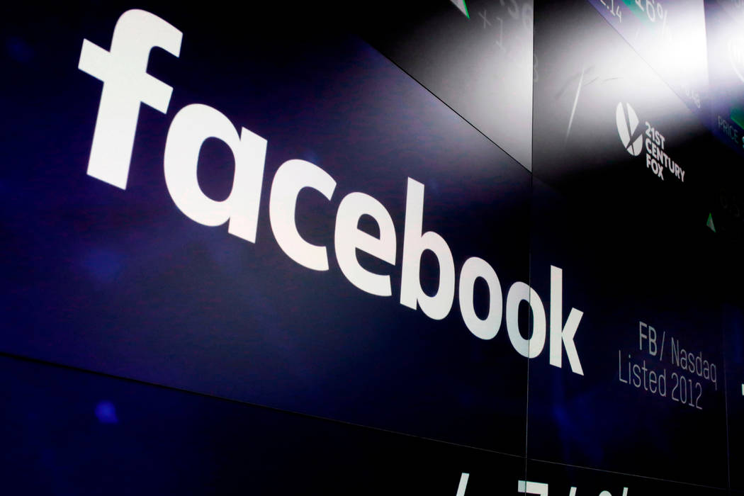 A March 29, 2018, file photo shows the Facebook logo on screens at the Nasdaq MarketSite in New ...