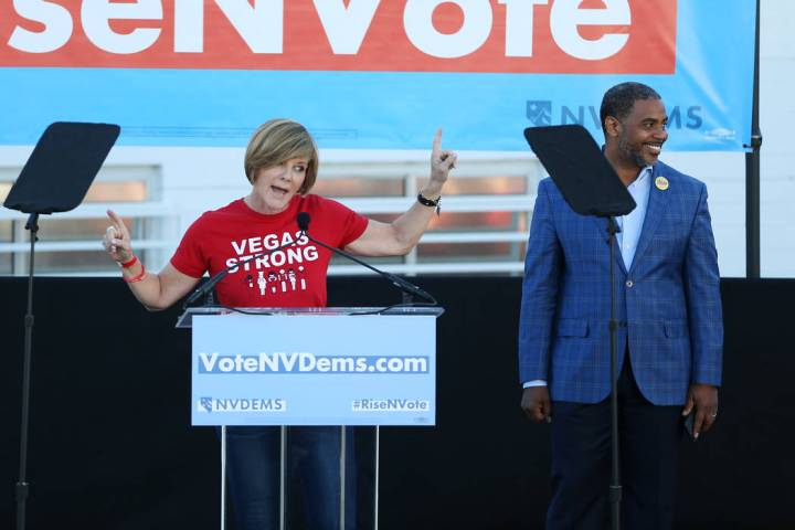 Democratic candidates for Congress Susie Lee, left, with Steven Horsford, speaks during a Nevad ...