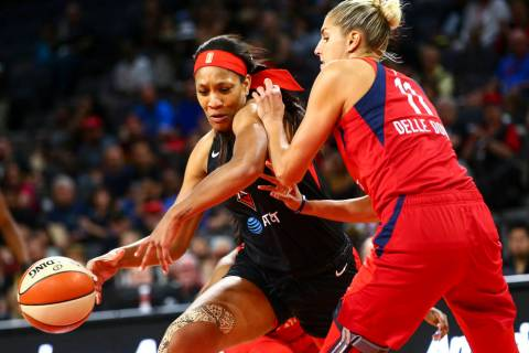 Las Vegas Aces center A'ja Wilson (22) moves the ball around Washington Mystics forward Elena D ...