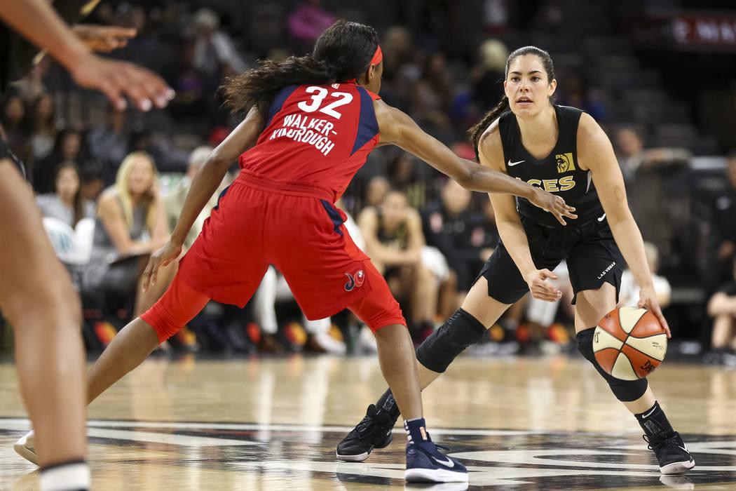 Las Vegas Aces guard Kelsey Plum (10) dribbles the ball as Washington Mystics guard Shatori Wal ...