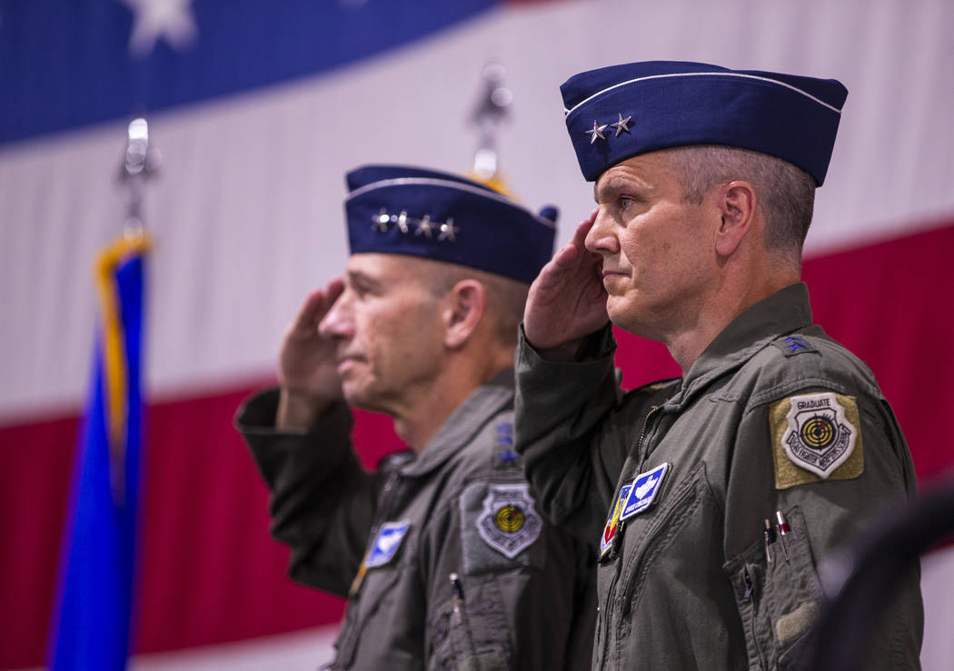 Maj. Gen. Charles Corcoran, right, and Gen. Mike Holmes, Commander of Air Combat Command, salut ...