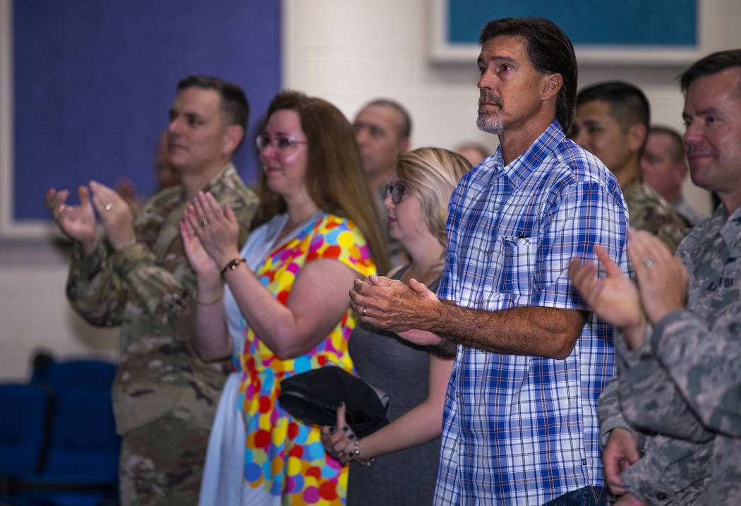 Ken DeLongchamp, right in plaid, applauds at Nellis Air Force Base on Friday, July 12, 2019, in ...