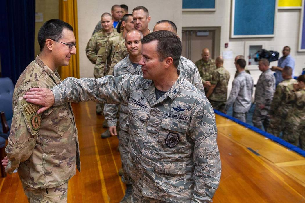 Staff Sgt. Kenneth DeLongchamp, left, is congratulated by other airmen at Nellis Air Force Base ...