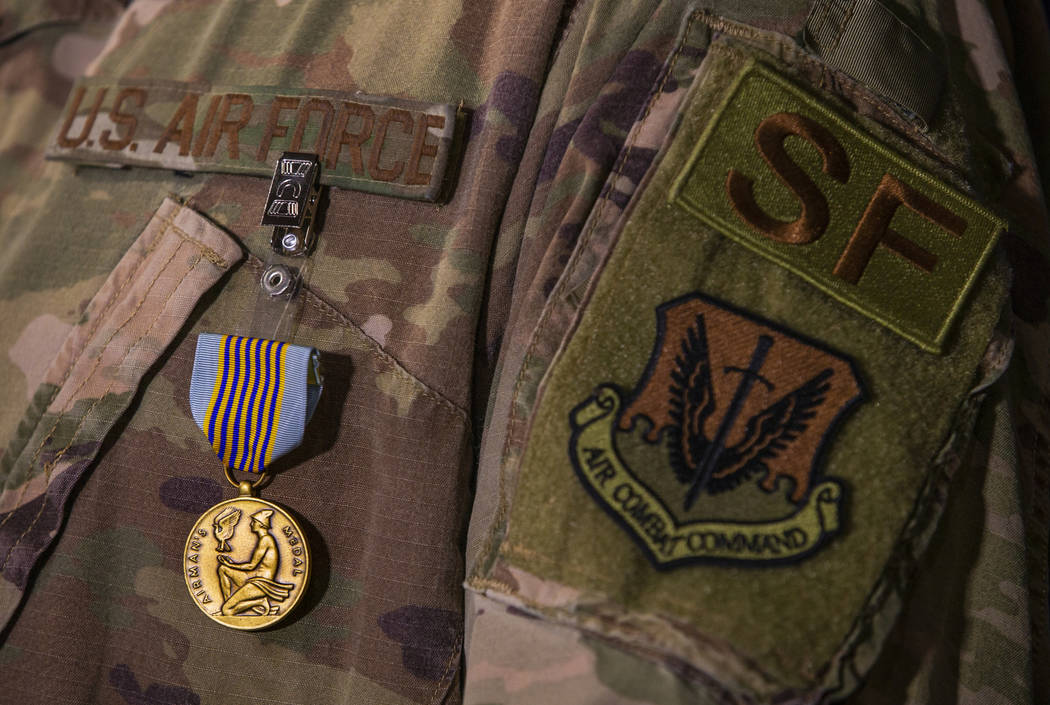Staff Sgt. Kenneth DeLongchamp wears his new Airman's Medal at Nellis Air Force Base on Friday, ...