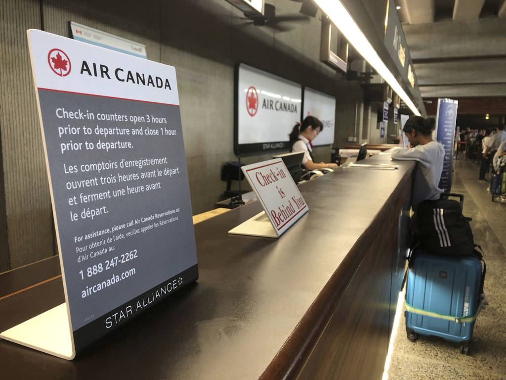 Passengers from an Australia-bound Air Canada flight diverted to Honolulu Thursday, July 11, 20 ...