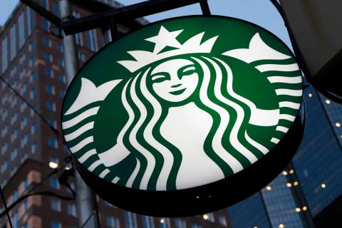 A Starbucks sign outside a Starbucks coffee shop in downtown Pittsburgh. (AP Photo/Gene J. Puskar)