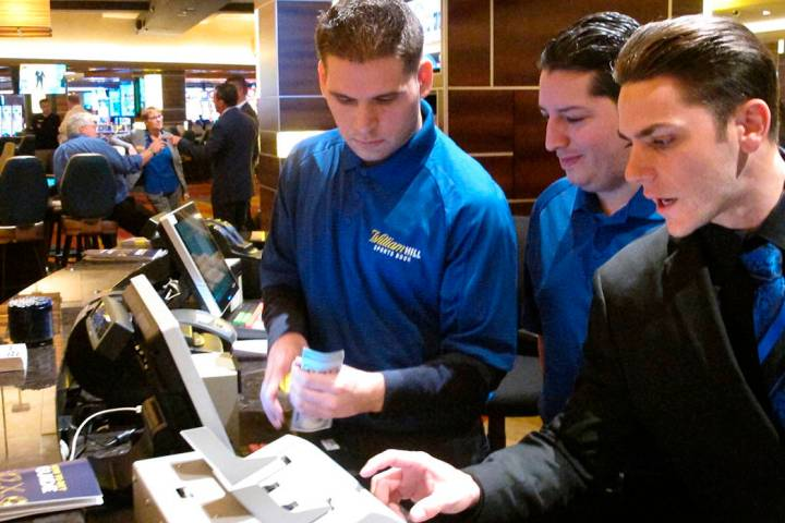 Employees at the sports book at the Tropicana casino in Atlantic City, N.J., count money moment ...