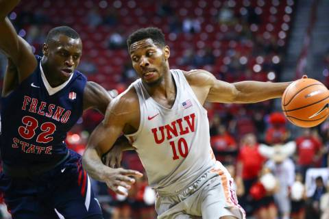 UNLV Rebels forward Shakur Juiston (10) drives against Fresno State Bulldogs forward Nate Grime ...